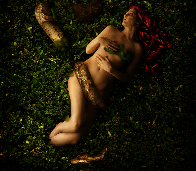 Eve laying with the serpent in the Garden of Eden