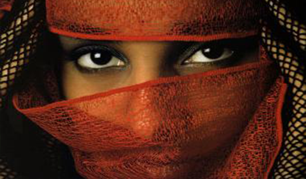 Woman with red veil showing only eyes