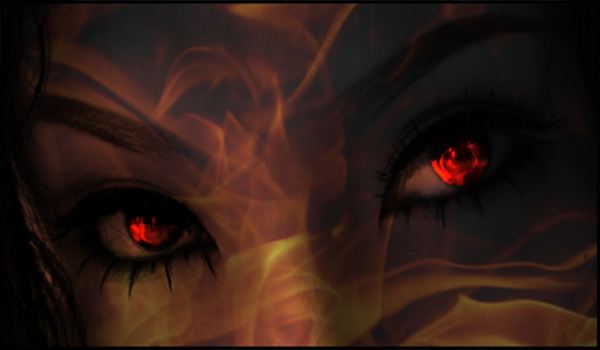 Face of burning goddess with fiery eyes