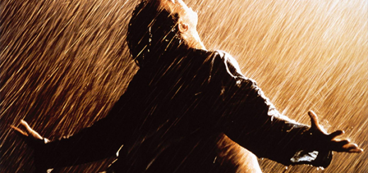 Man with arms spread against a mixture of rain and sunlight