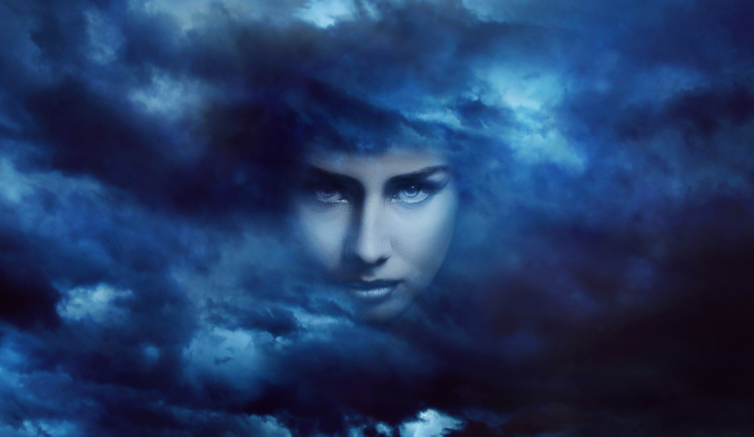 Woman's face in stormy clouds