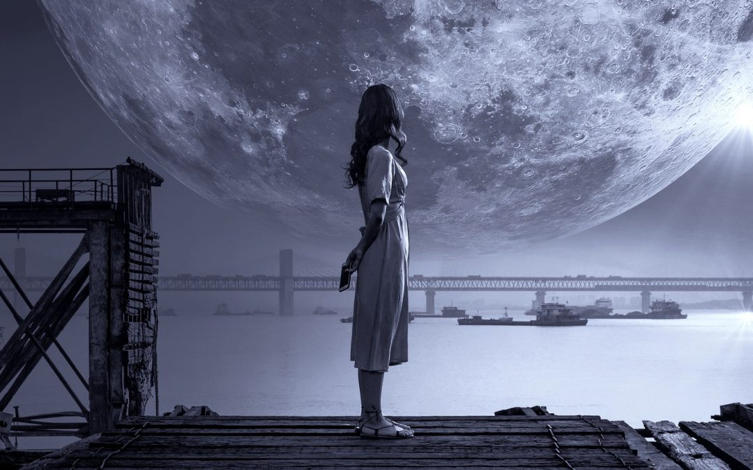 Woman looking at moon